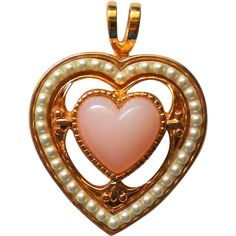 This little valentine heart has a gold tone metal base with a lovely pink heart at the center and tiny faux seed pearls surrounding it.  - found at www.rubylane.com @rubylanecom #VintageBeginsHere