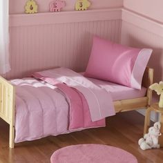 The lovely shades of dark pink and light pink accented with white trim on the Crispy Pink 4 Piece Toddler Bedding Set helps your toddler feel like such a big girl in her own bed. The four-piece bedding set in simple classic solids will coordinate with any decor. This bedding with its clean neat design will grow along with your child. Made from crisp 100% cotton This set is machine washable