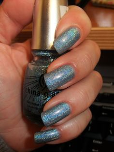 China Glaze Kaleidoscope Him Out… Sparkle, sparkle, sparkle and I simply adore it… Light blue based nail polish with scattered, rainbow like holographic effect. Under the sunlight or strong light this nail polish shows its full spectrum and gets really sparkly and pretty.