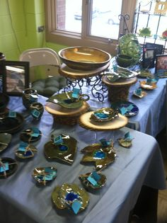 Fused glass pottery leaves and bowls from uponamemory.com sold at dreamscapes in Wauconda Illinois.