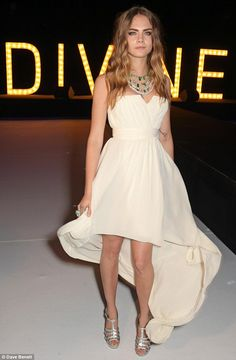 Angelic: Cara Delevingne looks lovely in a strapless white dress at the De Grisogono party in Cap d'Antibes on May 19, 2015