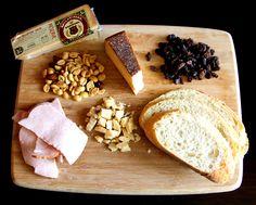 Balsamic BellaVitano with mixed nuts, raisins, smoked turkey and artisan bread.