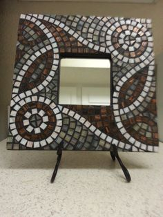 Made with tiny mosaic glass tiles, this mirror has a unique optical illusion effect. 10x10 mosaic mirror. it is a perfect mirror for the lover