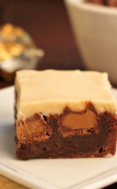 Recipe for Double Caramel Brownies - These start with a simple, one bowl brownie recipe…then after they are baked, chocolate covered caramels are pressed into the hot brownies. Cream cheese icing infused with caramel completes this dessert.
