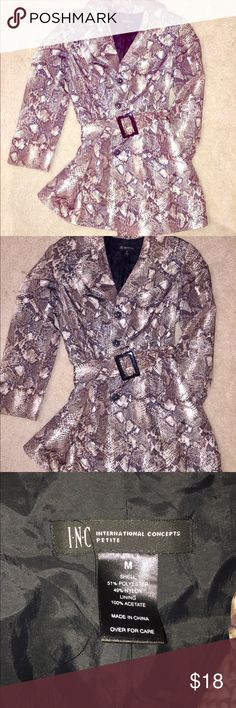 "INC Snake Print Rain Coat Size Size M International Concepts Petite  (In my opinion doesn't really fit like a Petite I'm 5'5"" and that's not Petite) Worn once in like new excellent condition  Snake Print trench coat style Rain coat the length falls right above the knee it ties at the waist to complement your curves  Shell is 51% polyester 49% nylon  Lining is 100% acetate INC International Concepts Jackets & Coats Trench Coats"