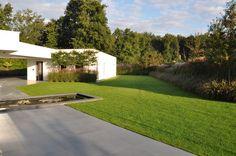 strakke tuin met grassen ontworpen door hans neelen hoveniers nunhem