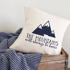 The Mountains Will Always Be Home Decorative Throw Pillow  •Dimensions: 12 x 12 inches 14 x 14 inches 16 x 16 inches  •Colors: Pillow: Cream Image: Black, Charcoal, Navy, Turquoise, Gold, and Silver Custom Color: Please click on request a custom order link above and we would be happy to create a pillow in the color of your choice.  •Materials: Pillow: 100% Cotton Medium weight canvas Image: Heat transfer vinyl Pillow Form: 100% polyester, Non-woven  •Construction: Back of Pillow Case is…