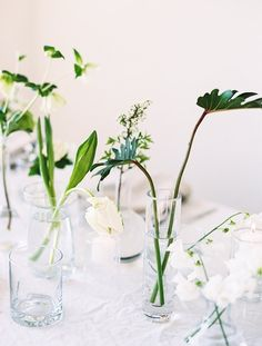 Easy greenery in mismatched vases on table