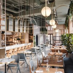 New York-based design studio Asthetíque has completed a restaurant in Moscow called The Y that draws on the stylised sets of films directed by Wes Anderson. Moscow Restaurant, Restaurant Concept, Restaurant New York, Restaurant Tables, Cafe Restaurant, Restaurant Design, Restaurant Interiors, Restaurant Ideas, Design Café