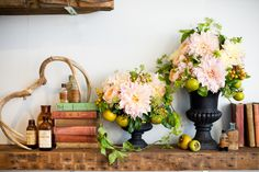 This is beyond magnificent. Pale pink and yellow dinner-plate dahlias and persimmons!