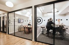 Co-working sharable office spaces defined by variety of pendant lighting solutions. wework-london-office-design-4