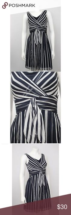 "Ann Taylor Petites Blue Striped Silk Chiffon Dress Ann Taylor Petites Navy Blue Striped Silk Chiffon Fit & Flare Dress.  Measurements (flat / un-stretched): Tagged Size: 00P Bust: 30"" Length (shoulder to hem): 35"" Ann Taylor Dresses"