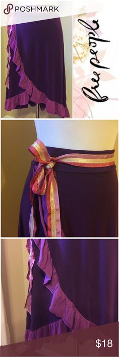 "Free People Purple Ruffle Wrap Skirt Waist Tie XS Free People Purple Ruffle Wrap Skirt Ribbon Waist Tie  • size XS • 95% tencel 5% spandex • Feels like stretch jersey knit  • 3 ribbons sewn together create waist tie sash • 13"" waist (w/ skirt flat) • Waist has elastic band & stretches well past 13"" • 29"" at longest point, 21"" at shortest • sash is attached on left side of waistband. sash pulls through a loop on right side of  waist Tie is 78"" long 1.25"" wide.  • All measurements are…"