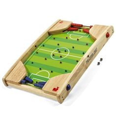 Wooden Football Pinball - http://www.uptothemoon.com/product/wooden-football-pinball/