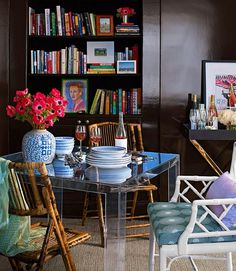 Library or Dining Room? Adore the lucite table and lacquered walls.