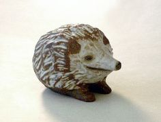 Ceramic Hedgehog with textured fur and a sense of humor is part of Andersen Studios Ceramic Animals Art Collection.