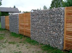 Very cool gabion basket and wood slats fence.