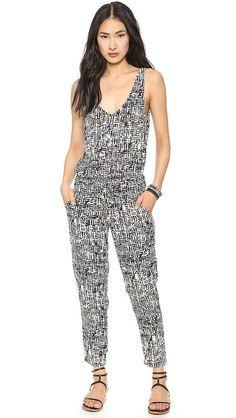 Selena Gomez Black-and-White Jumpsuit and White Coach Bag | POPSUGAR Fashion