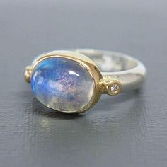 This unique bold, statement ring is a one of a kind 100% handmade creation. Ring is built around natural high grade rainbow moonstone . Amazing stone with incredible blue flash and natural inclusions. Will be a lovely present for you or your loved one. The sterling silver ring and 14k