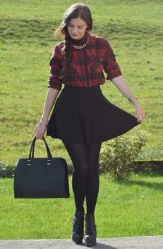 black skater skirt with a red and black plaid shirt with gold chains and black leggings