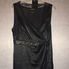 Fancy black lace trim, tie sleeveless shirt Purchased but doesn't fit me. Perfect condition no snags, rips, holes, or missing sequence. Silky light weight beautiful top size 16 Lane Bryant Tops Camisoles