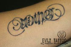Mother father ambigram at evilz tattoo by manish muchhadiya