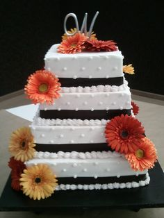 Buttercream Wedding Cake - Square Buttercream wedding cake with silk flowers  Gerber Daisies