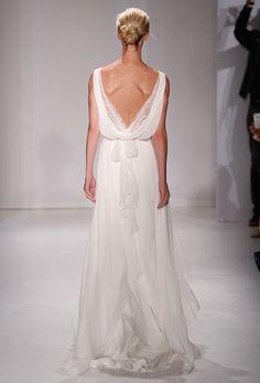 A draped-back wedding dress by @ christosbridal   Brides.com