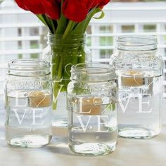 cool idea- floating candles in mason jars (we could even do 1/2 mason jars)  Cathy's Concepts Modern Love Mason Jar Centerpieces (Set of 4) (Gla) - LD1285