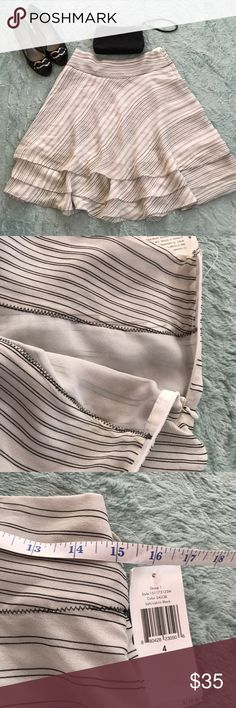Calvin Klein silk skirt Beautiful Calvin Klein silk skirt. Somewhat sheer. Size 4. NWT Calvin Klein Skirts
