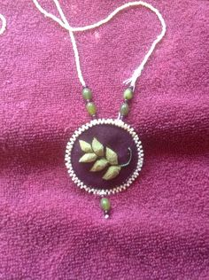 Caribou hair embroidered pendant by Bonnie Bowen