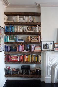 bookshelving beside fireplace
