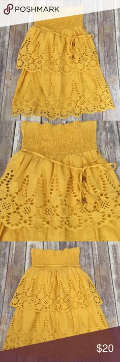 "Anthropologie Flying Tomato Eyelet Skirt Dress Top Gorgeous yellow Eyelet piece from Anthropologie by Flying Tomato. This can be worn as a mini dress, tube top, or skirt, so it's very versatile. Belt around waist with wooden bead detail. Size medium and in excellent condition with no flaws. Total length is 26"" unstretched. ⚓️No trades or holds. I accept reasonable offers unless the item is priced at $8 or less and then the price is FIRM. I only negotiate through the offer button. I do not…"