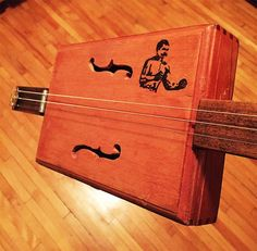 How to Make a Cigar Box Guitar   The Art of Manliness