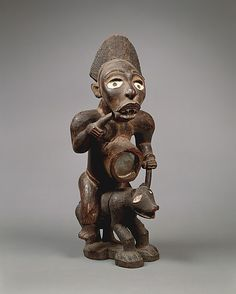 Power Figure: Male Riding Dog (Nkisi) | 19th–20th century | Democratic Republic of the Congo, Kongo peoples | Wood, glass, pigment