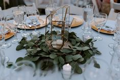 Simple Eucalyptus Garland Centerpieces  photo by: rachael marie photography flowers: love sparrows  #eucalyptuscenterpieces #garland #terrarium #terrariumcenterpieces #greenerycenterpieces #centerpieces #wedding #simplecenterpiece