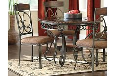 """The Glambrey Dining Room Table from Ashley Furniture HomeStore (AFHS.com). With the scrolling tubular metal bathed in a dark bronze color finish beautifully supporting the brown cherry finished table top adorned with a decorative rope twist edge profile, the """"Glambrey"""" dining collection flawlessly captures the true atmosphere of classic Old World design to enhance the look of any dining room."""