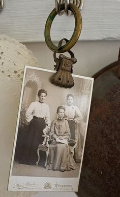 Old curtain clips to hold photos.
