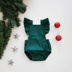 Baby girls Christmas romper // playsuit // ruffle wing // tie back // green // baby gift // by whatmollywears on Etsy https://www.etsy.com/listing/568110531/baby-girls-christmas-romper-playsuit