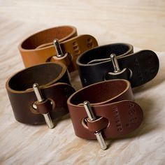 "Leather cuffs with an intersting ""clasp""."