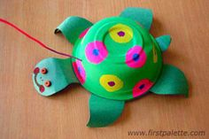 Paper Bowl Turtle. Easy to follow directions on website. Supplies: construction paper, bowl, paint/markers, crayons, string, googly eyes, beads, glue, scissors.  Ideas: instead of painting the shell, let kids have fun with gluing sequins and green tissue paper to give the shell a glittery effect.