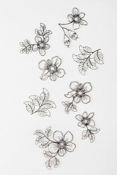 Wire Flower Sculpture Wall Art - Set Of 8  #UrbanOutfitters        Have these in our bedroom. They look FABULOUS!