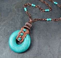 Turquoise donut with a hand made copper woven bail. --Lisa Barth