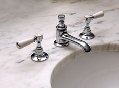 From Waterworks Studio, the elegant Highgate Low-Profile Lavatory Faucet with white porcelain lever handles