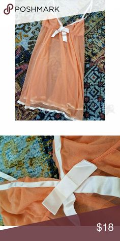 Victoria's Secret Angels nighty Victoria's Secret Angels nighty baby doll. Orange with ivory ribbon detail. This item is completely sheer! Size medium, adjustable ribbon straps. Used but in excellent condition. Victoria's Secret Intimates & Sleepwear Chemises & Slips