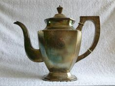 Nanking Silver Coffee Pot - Early Chinese Export Silver almost exclusively took the form of copies of British or American classical Georgian styles. This gradually evolved into incorporating overtly Chinese motifs to these classic forms. The style had evolved into an extravaganza of Chinese motifs that, in the true high Victorian manner, completely covered silver items to the point where plain polished surfaces were virtually banished or thought unthinkable.