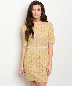 https://www.porporacr.com/producto/vestido-beige-flores-doradas-encargo/
