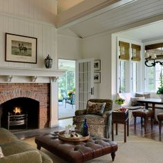 paneling above red brick fireplace