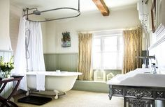Photograph of a room designed by The Treehouse Interiors. Nice retro look - the wainscoting, claw-foot bathtub, filigree sink base... http://www.bathroom-paint.net/