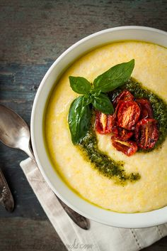 Creamy Cheddar Polenta with Pesto and Oven-Roasted Tomatoes.  I love how the food is the hero in this pic. #foodphotography #styling #simplicity